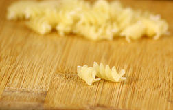 Twisted pasta couple on bamboo desk Stock Image