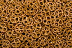 Twisted Pretzels. Mini salted twisted pretzels as background Stock Photo