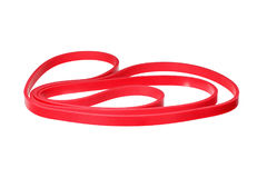 Twisted red rubber wrist band isolated on white. Macro photo Royalty Free Stock Photo