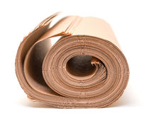 Twisted into roll brown wrapping paper Royalty Free Stock Photo