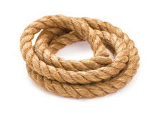 Twisted rope. Twisted thick rope on white stock images