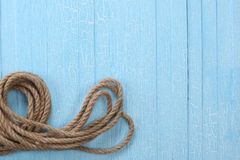 Twisted rope on blue boards Stock Images