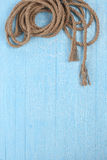 Twisted rope on blue boards Stock Image
