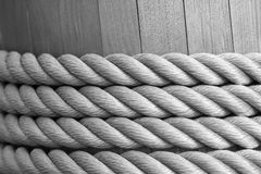 Twisted rope is reeled up on a wooden drum Royalty Free Stock Image