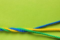 Free Twisted Ropes On Color Background, Top View. Stock Photo - 116725040