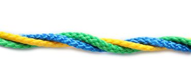 Twisted ropes strings on white background. Unity concept stock photos