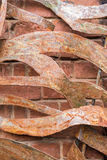 Twisted and rusty iron plates on an old brick wall Royalty Free Stock Photography