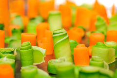 Twisted slices of carrot and zucchini Stock Images