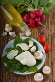 Twisted Slovak Cheese On Plate With Vegetable Around Stock Photos