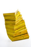 Twisted stack of old paperback books Stock Image