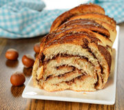 Twisted sweet bread with chocolate and nuts Stock Photography