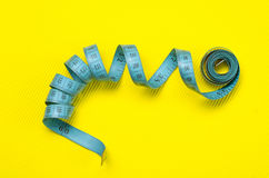 Twisted tape measure Royalty Free Stock Images