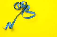 Twisted tape measure Royalty Free Stock Photo
