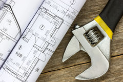 Twisted technical drawing and adjustable wrench Stock Image