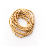 Twisted thick rope on white Stock Photography