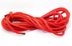 Twisted thick rope on white. Red Twisted thick rope on white Royalty Free Stock Image