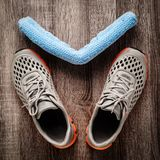 Twisted towel and sneakers Royalty Free Stock Photography