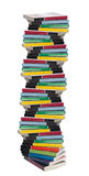 Twisted tower of colorful real books stock images