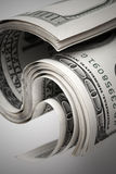 Twisted United States dollars. Hundred USD banknotes Royalty Free Stock Photography