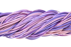 Twisted violet network computer cables Royalty Free Stock Photo