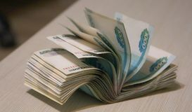 Twisted wad of money, banknote packing royalty free stock photos