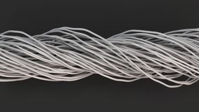 Twisted white cables and wires on black surface. Computer or telephone network. 3D rendering illustration Stock Photo