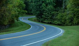 Twisted winding country backroad. Summertime in Tennessee on twisty turning backroads on the Natchez Trace Parkway stock images