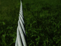 Twisted wire. Focus on wire disappearing in to distance Stock Photos