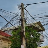 Twisted wires of a power line stock photo