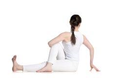 Twisted yoga pose Stock Photography