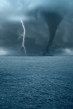 Twister on the ocean. Twister and lightning over the ocean Stock Image