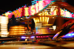 Twister  ride. Blured motion image of a fairground twister ride Stock Image