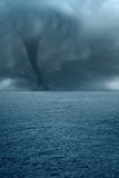 Twister on the sea. Twister with dark clouds on the ocean Royalty Free Stock Image
