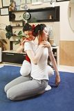 Twisting body. Masseuse twisting young women body during yumeiho massage. This oriental therapy is a complex set of manual procedures and physical exercises Royalty Free Stock Photo