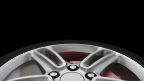Twisting car wheel close-up with an alpha channel. HD stock video