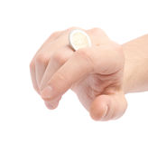 Twisting coin with the knuckles Royalty Free Stock Photos