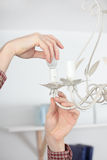 Twisting a light bulb Stock Photos
