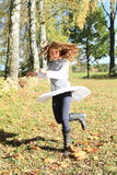 Twisting little girl. Twisting kid - happy girl with flying hair and white skirt Royalty Free Stock Photo