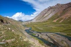 Twisting river Jil-Suu in Kirgizia Royalty Free Stock Image