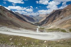 Twisting road going to Barskoon pass, Kirghizia Stock Photography