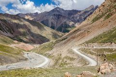 Twisting road from Kumtor gold mine, Kirghiizia Royalty Free Stock Photo