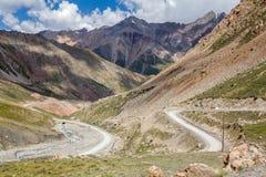 Twisting road from Kumtor gold mine, Kirghiizia Royalty Free Stock Photo