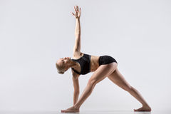 Twisting Triangle Pose Stock Image