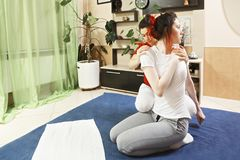 Twisting woman body. Masseuse twisting women body during yumeiho massage. This oriental therapy is a complex set of manual procedures and physical exercises Stock Photos