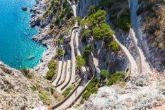 Twisty road on Capri island. Mediterranean sae, Italy stock photography