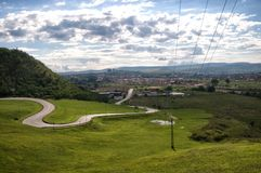 A twisty road landscape scene in Romania with cloudy sky royalty free stock image