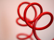 Twisty twirly coil. A wire looking like a telephone coil enlarged Stock Photos
