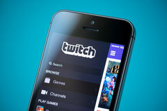 Twitch application on Apple iPhone 5S. Kiev, Ukraine - September 24, 2014: Close-up shot of brand new Apple iPhone 5S with Twitch video streaming service Royalty Free Stock Images