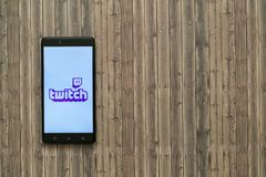 Twitch logo on smartphone screen on wooden background. Los Angeles, USA, november 7, 2017: Twitch logo on smartphone screen on wooden background Stock Photography