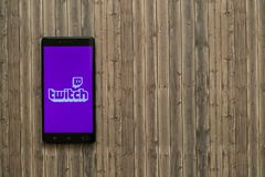 Twitch logo on smartphone screen on wooden background. Los Angeles, USA, november 7, 2017: Twitch logo on smartphone screen on wooden background Royalty Free Stock Photos